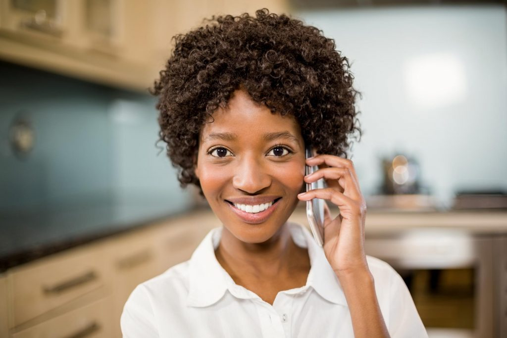 woman smiling talking on the phone