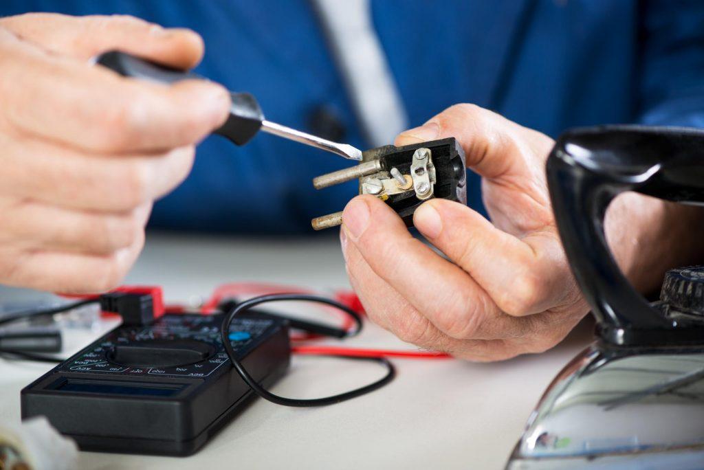 appliance repairman doing electrical repair